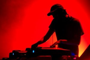 band_silouette_of_dj_turntable_red_background-1