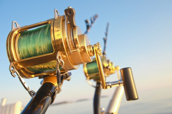 fishing_reels_and_rod_lit_by_sunset_95447152-1
