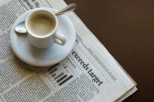 event_meeting_newspaper_with_coffee_cup_sitting_on_it-2