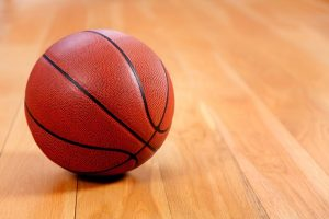 sports_basketball_on_wooden_court_60851746-9