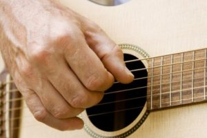 acustic_guitar_being_played_up_close_ExploreOCMD-1